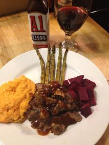 Recording Artist Ava Aston - thanksgiving dinner including a london broil steak with A-1 Steak Sauce, asparagus, sweet potatoes, beets and a glass of wine.